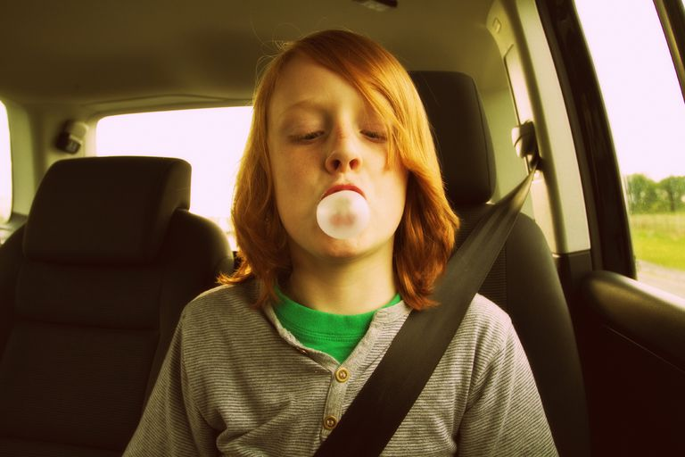 Boy blowing bubble gum bubble