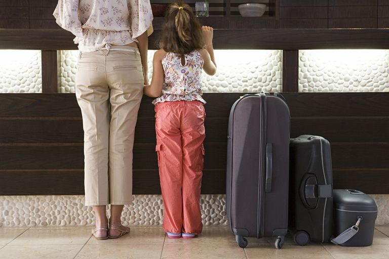 Woman and daughter checking in at a hotel