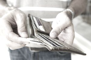 A man pulls cash from a wallet