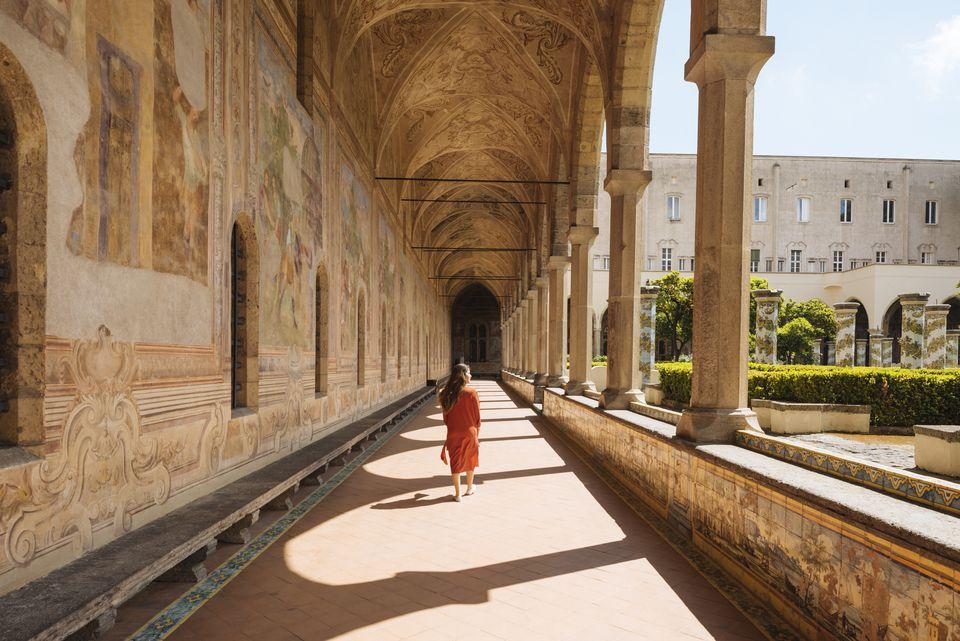 Woman in corridors, Santa Chiara Monastery, Campania, Italy