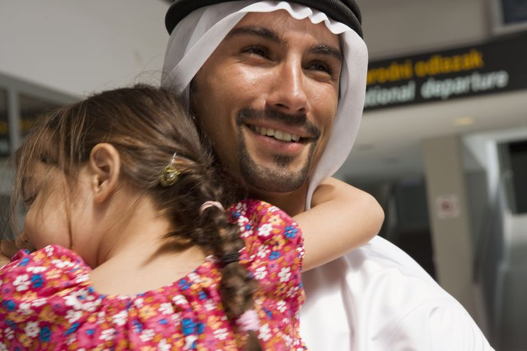 Father and daughter at the airport