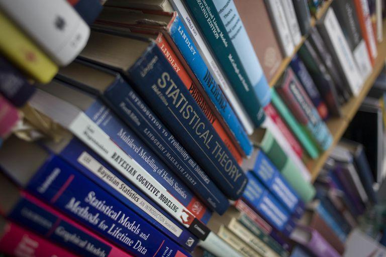 Academic books on a shelf