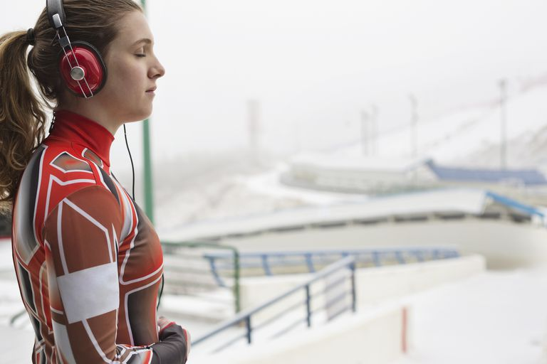 Female luge athlete preparing for race