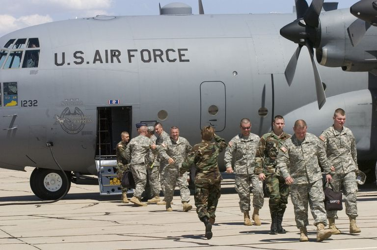 National Guard troops getting off C-132 transport in Arizona