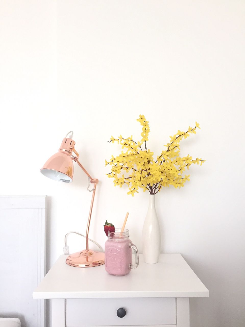 bedside lamp, flowers and breakfast smoothie