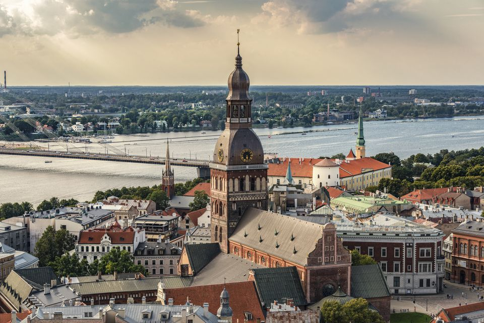 Latvia, Riga, cityscape with cathedral, castle, and Vansu Bridge