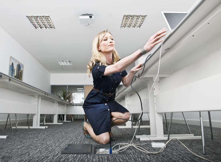 woman setting up presentation