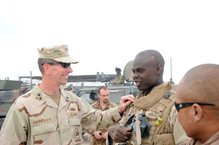 Rear Admiral Speaking To Seabee