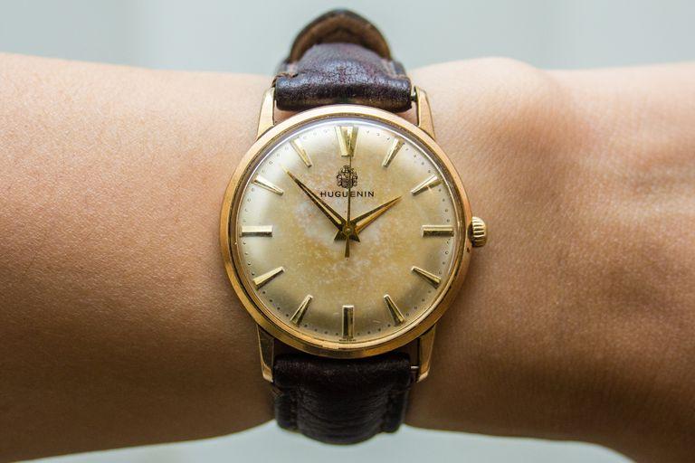 A wristwatch worn by a person.