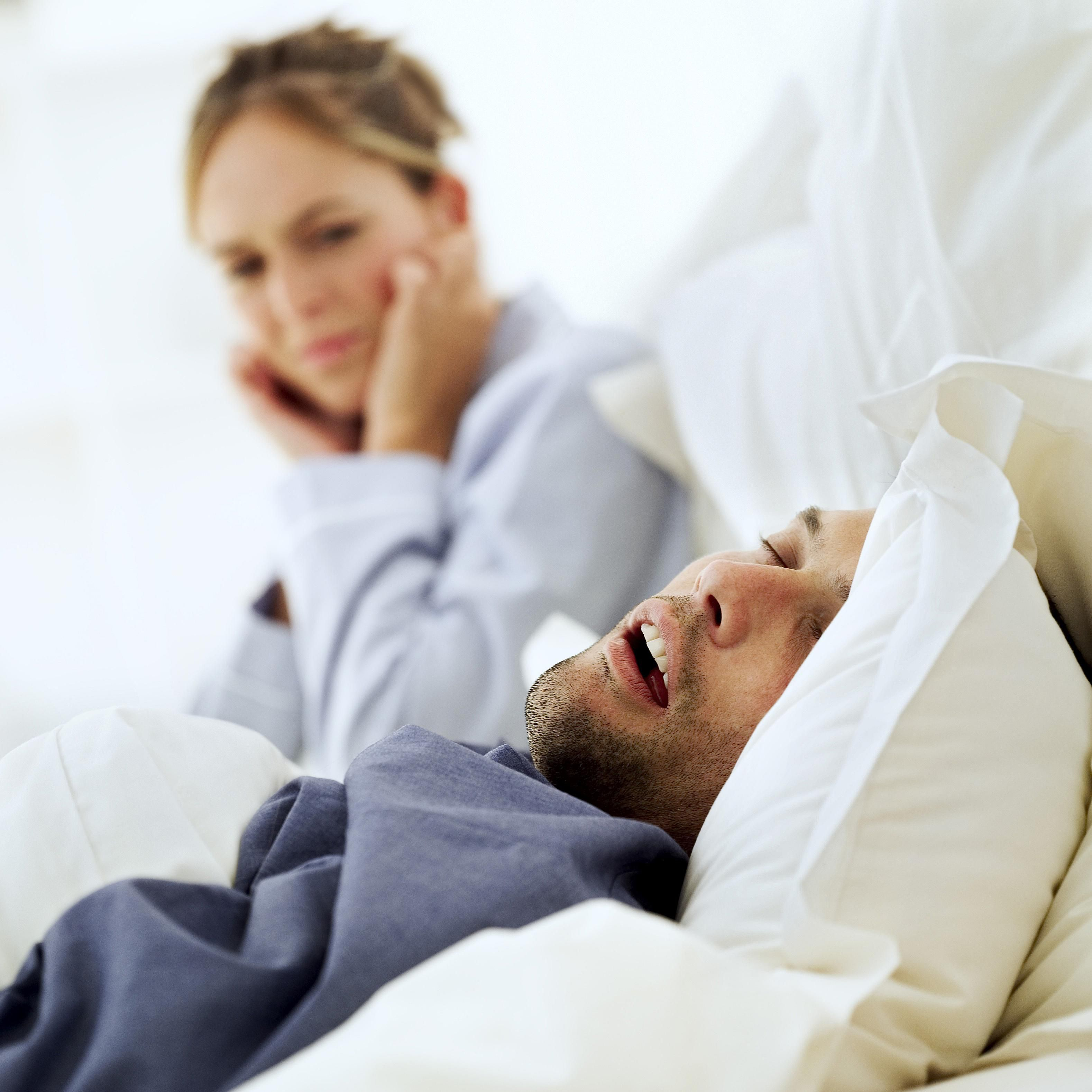 a covering remedies her discussion mayo pillow network woman and stop with the snoring man in aged ears couple news home middle clinic shutterstock bed