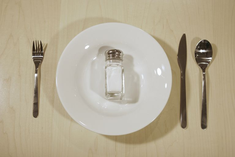 Salt in a bottle on a plate.