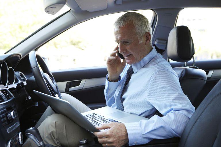 Businessman working in car