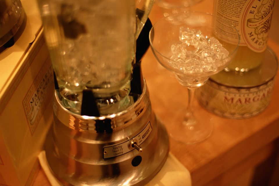 Blender and crushed ice in wine glass