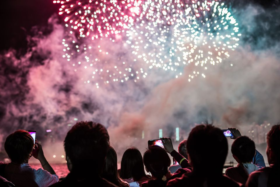 People watching fireworks from behind