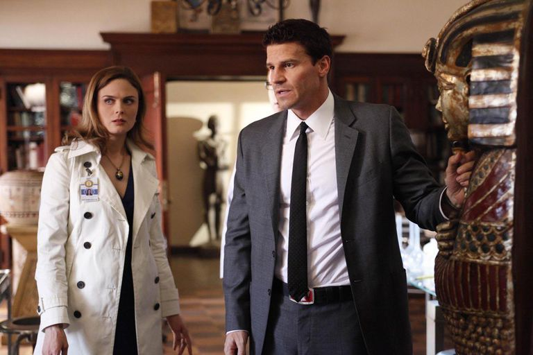 Brennan (Emily Deschanel, L) and Booth (David Boreanaz, R) are surprised at what they find when they examine a sarcophagus in the BONES episode