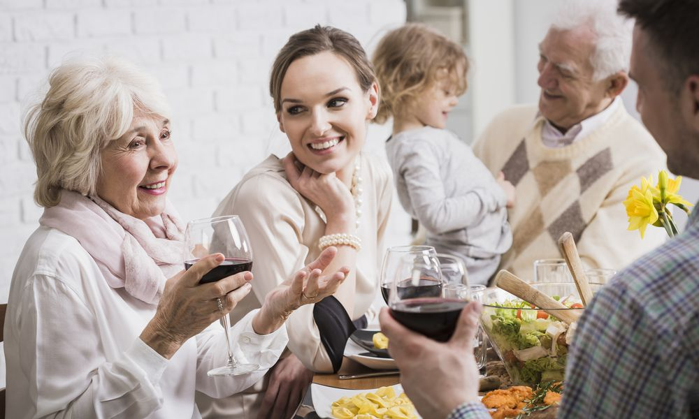 generations celebrating the holiday together talking about family history