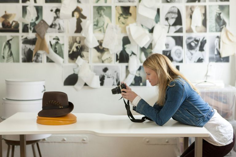 woman photographing hat for blog