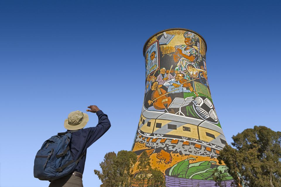 Tourist Looking at Painted Chimney in Johannesburg