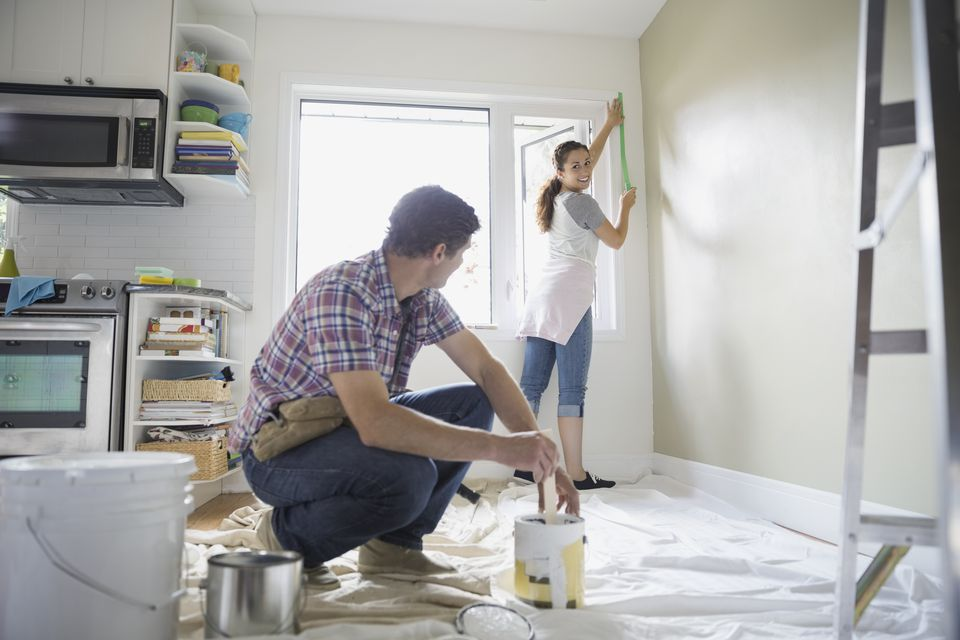 Couple starting painting project in living room