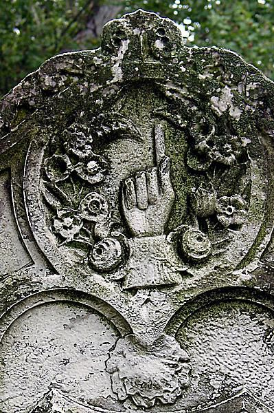 Hands with the forefinger pointing up or down are a common symbol on cemetery tombstones
