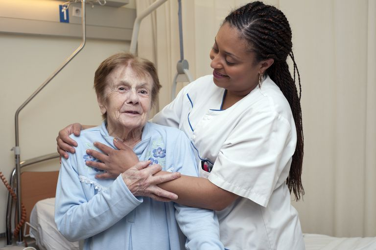 Nurse posing with senior woman