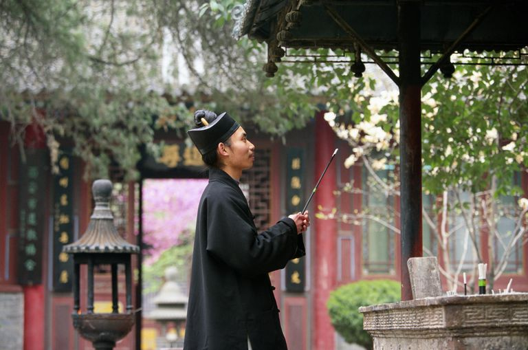 China, Shaanxi, Taoist monk at Xian monastery, side view