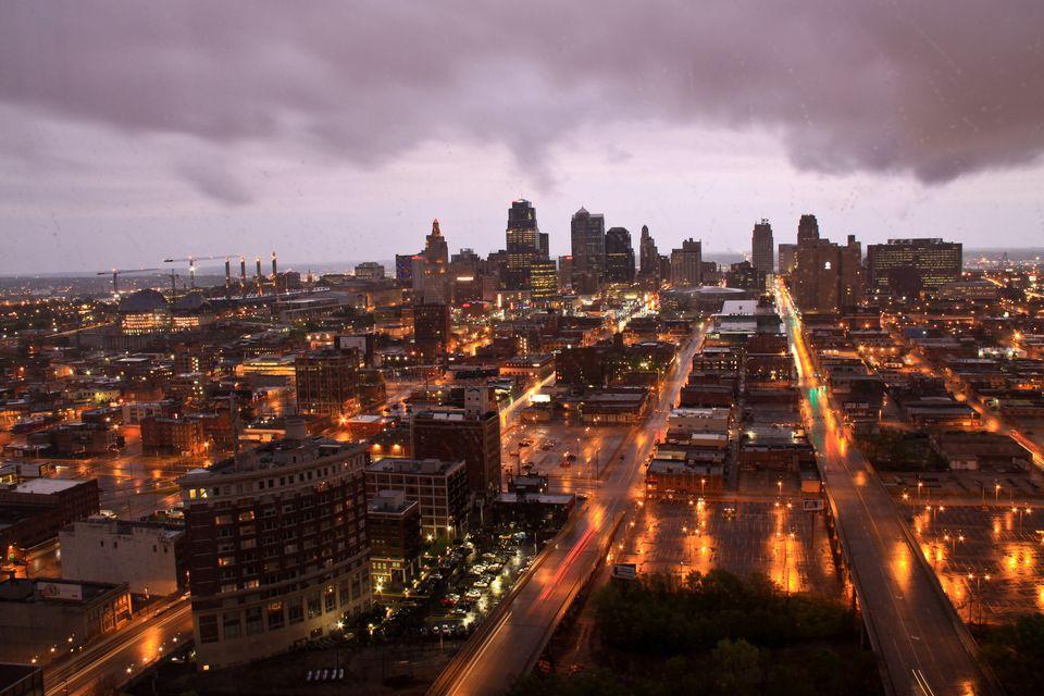 Downtown Kansas city, Missouri with passing rainstorm at sunrise taken from near top of Hyatt Regency hotel, Crown center.