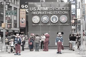 Costumed characters Mickey and Minnie Mouse, Super Mario and Elmo greet tourists in front of the Armed Forces Recruiting Station in Times Square