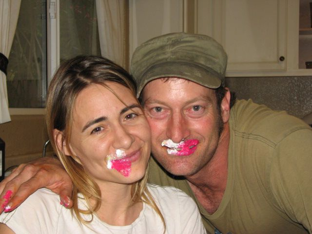 Deanne Bray Kotsur and Her Husband Troy Kotsur, with cake on faces.