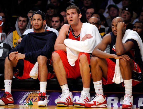 Devin Harris, Brook Lopez and Trenton Hassell look on as the Nets lose their 17th straight game to s