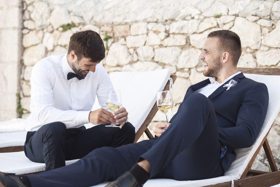 Groomsmen and groom talking