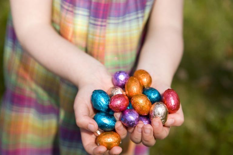 girl holding too many Easter Eggs