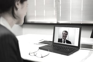 Businesswoman talking to businessman on video conference
