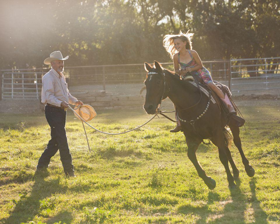Young girl horseback riding