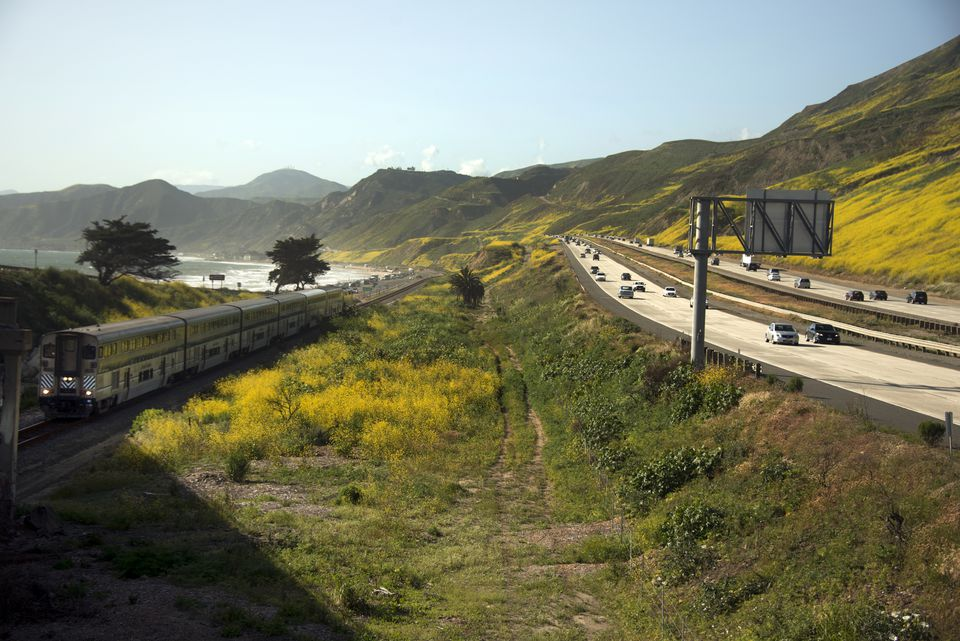 Train and road traffic on Highway 101 along the California coast between Ventura and Santa Barbara