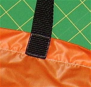 Photo of a sewn on strap.