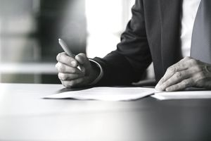 Businessman signing letter