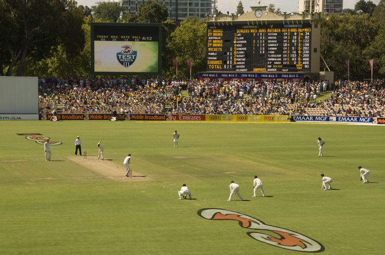 Test cricket match at the Adelaide Oval with the heritage scoreboard in background.