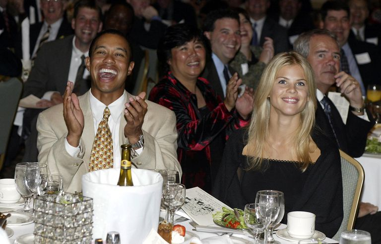 Tiger Woods and Elin Nordegren share a laugh.