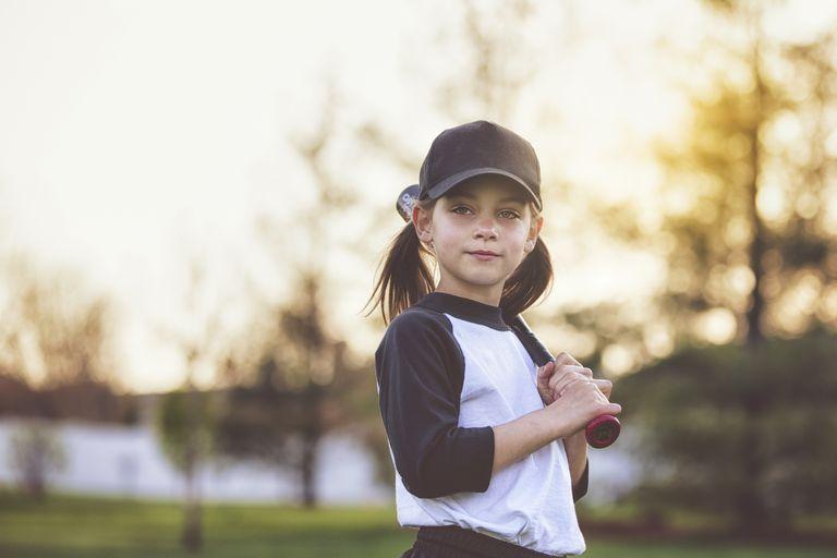girl holding baseball bat