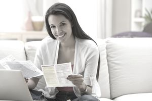 Woman paying variable expenses