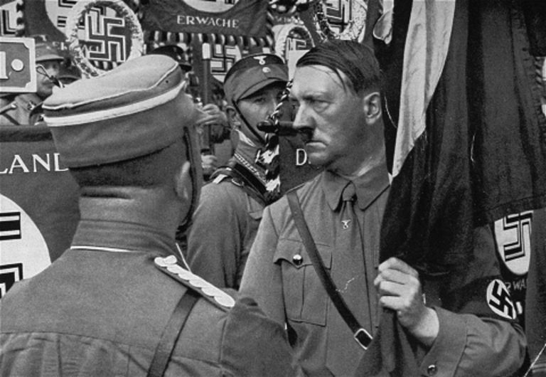 "Hitler holding the ""Blood Flag"" at the 1934 Reich Party Day"