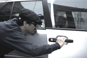 Man breaking into a vehicle