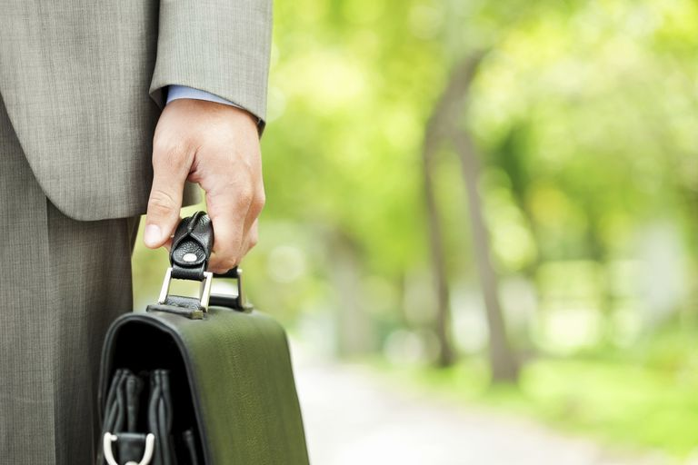 Man holding briefcase.