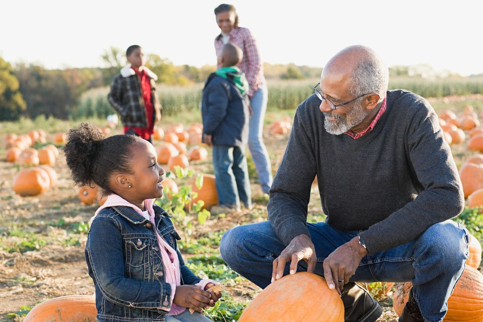 a grandfather and his granddaughter looking at pumpkins - Minneapolis Halloween Events