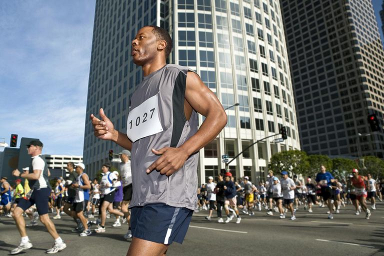 African American male running in a large city marathon