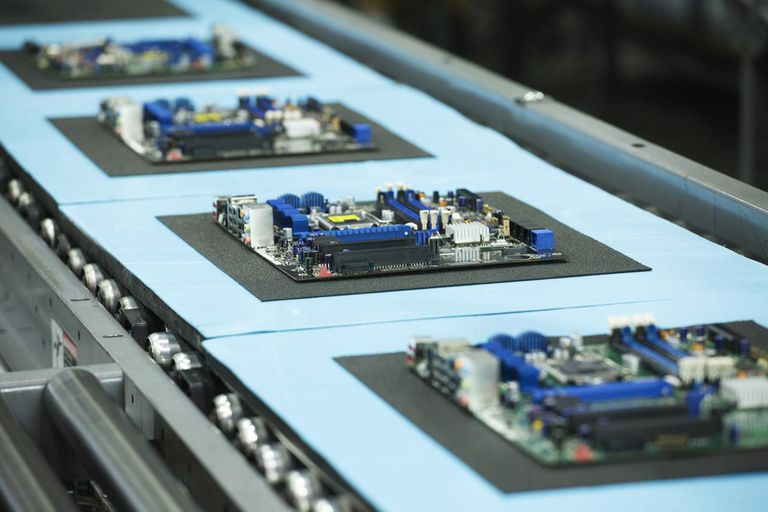 Motherboards on conveyor in manufacturing facility
