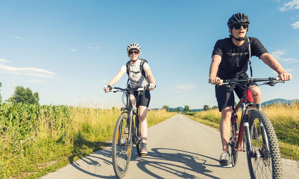 Young couple biking
