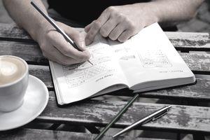 Man draws a sketch graphic design