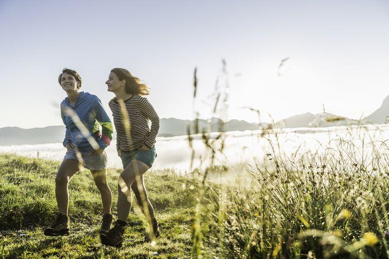 Two female friends hiking, Tyrol, Austria